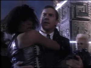 Kevin Costner in a scene from teh Hollywood movie The Bodyguard  - Right before he kicks a man in the chest while carrying his principal to safety!